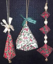 Another opportunity to make unique Christmas decorations for your tree.  Stiffened fabric is folded and faceted to create wonderful jewels.