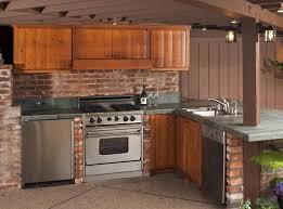 wooden outdoor kitchen cabinet combined with brick wall