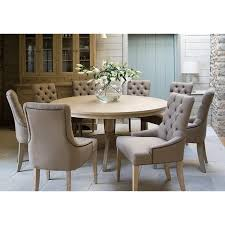 henley round six seater dining table shown here with henley upholstered dining chairs