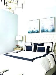 chandelier over bed art over bed bedroom transitional with wall contemporary chandelier over bed art over chandelier over bed