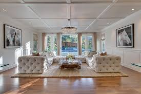 traditional living room with chandelier french doors in saratoga