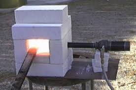 how to make a brick forge. the image at right shows burner inserted through this hole. was test firing to see if my forge design would even work. how make a brick k