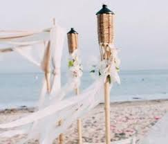 lighting tiki torches. tiki torches lining the aisle of your beach wedding lighting l
