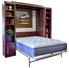 wall bed office. bookcase wallbeds these look like dignified bookshelves but pivot open to reveal a bed that pulls down great addition home office or even wall