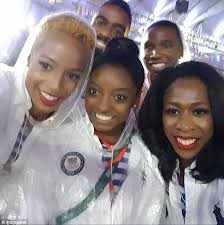 Image result for simone biles with selfies while carrying US flag at rio