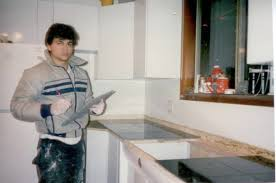 a young tom munro pictured holding a piece of granite as he works on his first