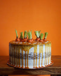 Triple Layer Carrot Cake With Caramel Drip And Fresh Carrot Tops