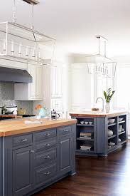 blue gray kitchen islands with maple butcher block countertops