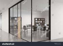 wooden office buildings. Close Up Of A Glass Office Lobby With Wooden Door, Concrete Floor And Buildings