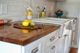 refinishing transitional kitchens dark finish butcher block countertop a front kitchen sink polished