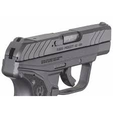 a fixed front and rear sights are integral to the slide