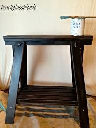 space saving black sawhorse table design