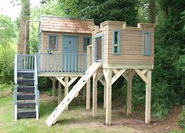 wooden treehouse with lookout tower and climbing wall