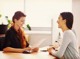 Two women in an interview process. The direct approach: phone and face-to