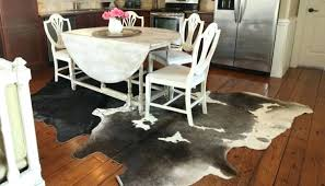 cowhide rugs under table cow skin rug ikea skinny on decorating with