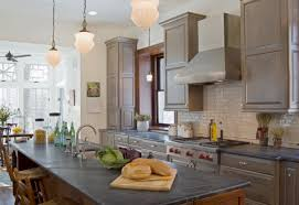furniture grey countertops connected by pale brown wooden kitchen cabinet and beige tile backsplash