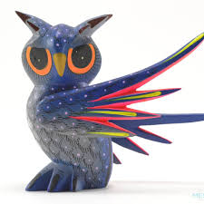 alebrijes are whimsical carvings depicting animals carved from copal wood the figures are sanded and hand painted the wings of the owl disassemble to paint
