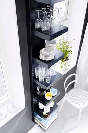 fit a lot of dinnerware and drinkware storage into a tiny bit of space with lack wall shelf unit