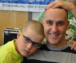 a new definition of beauty photo essay  bald father and son