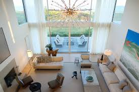 flying point residence modern living room new york by stelle inside chandelier for high ceiling prepare 17