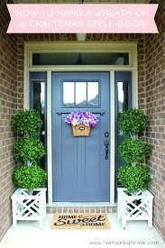 hanging wreath on door how to hang a wreath on a craftsman style door and sources hanging wreath on door