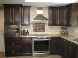 this kitchen contains alabaster white lexington maple cabinetry calacatta quartz countertops glass doors with inside lights yelp