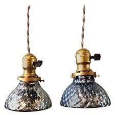 pair of petite blue mercury glass pendant lights with brass ers 1