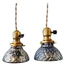 pair of petite blue mercury glass pendant lights with brass fitters for
