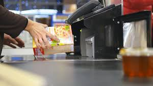 conveyor belt grocery store. shopper paying for products at checkout. foods on conveyor belt the supermarket. cash grocery store i