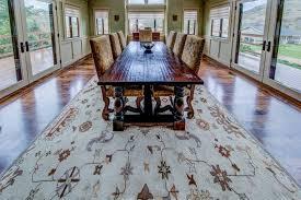 area rug over a custom stained hickory hardwood floor
