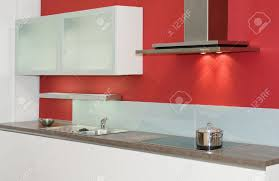 Red Wall Kitchen Modern Built In Kitchen With Red Wall Stock Photo Picture And