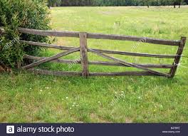 wire fence gate. Barbed Wire Fence And Wooden Gate On Polish Countryside