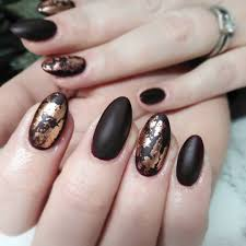 golden nail art for almond shaped matte black nails