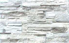 white and gray stacked stone fireplace grey wall