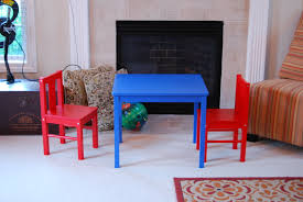 awesome ikea children furniture with red chairs and blue kids table in white living room design