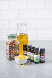 ings for diy hot and cold sore muscle rub arranged on a grey counter oil