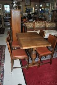 english oak pub table: antique oak pub table and  chairs with two  inch leaves