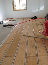 thermofin u aluminum heat transfer plates are installed under a new floor in a radiant heating