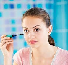 a putting on makeup