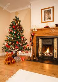 Xmas Decoration For Living Room Living Room With Christmas Decorations A Fireplace And Christmas