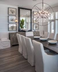 luxe farmhouse dining room with orb chandelier