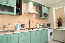 Peach Kitchen Breezy Mint Cabinets Peach Ceramic Tile Backsplash White Vent Hood