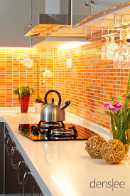 Beautiful use of orange tile as a counter top backsplash in the kitchen.  Just stunning