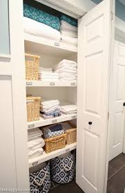 organized linen closet i m loving the transformation