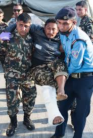 u s department of > photos > photo gallery a ese army ier and airport security guard help an earthquake victim into an ambulance at