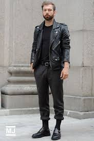 this pairing of a black leather motorcycle jacket and dark grey wool trousers is hard proof