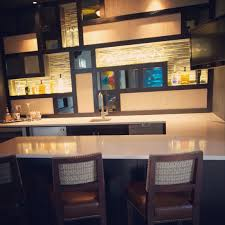 Studio B Design Group Gorgeous Bar With Custom Mosaic Insets And Led Lighting With