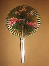 hand fan metal. vintage metal paper bird cardinal chicken flower hand fan . hand fan metal
