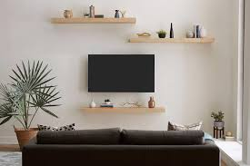 tv with floating shelves