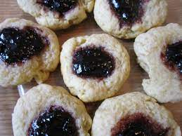 Make an indentation with your thumb and fill with jam. Austrian Jam Cookies Leslie The Foodie
